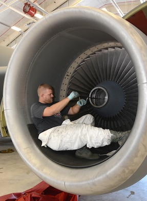 Tech. Sgt. Dustin Staude, a jet engine mechanic from the 507th Propulsion Maintenance shop, installs fan blades on an F108 engine following a 1500 flight-hour fan blade inspection Sep. 3, 2015, at Tinker Air Force Base, Okla. The shop is responsible for inspecting and maintaining the 40 engines for the KC-135 Stratotankers in the 507th Air Refueling Wing's inventory. (U.S. Air Force photo/Tech. Sgt. Lauren Gleason)