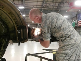 Master Sgt. Richard Miller, a machinist technician at the 158th Fighter Wing, created a reusable tool that allows a single person to fix a structural issue on F-16s that traditionally takes three Airmen two weeks of work to remove and reinstall a major portion of the aft end of the aircraft. Miller's new tool saves the U.S. Air Force more than $33,000 per fix. (Courtesy Photo)