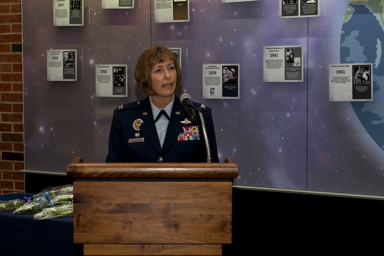 Col. Michelle Hayworth, 688th Cyberspace Wing Commander, addresses the audience during the activation of the Cyberspace Operations Group Dec. 1, 2015 at Scott Air Force Base, Ill. The 688th Cyberspace Operation Group is the third group within the Wing, which will lead in the Air Force's Cyberspace Protection Team concept by focusing on mission assurance of National, Joint and Service-level missions in all domains- air, space and cyberspace. (U.S. Air Force Photo/Senior Airman Joshua Eikren)