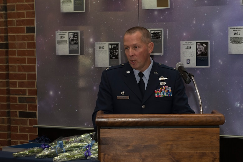 Col. Roger Vrooman, 688th Cyberspace Operations Group Commander, speaks to the audience after accepting command of the group at Scott Air Force Base, Ill. Dec. 1, 2015. The groups mission is to perform cyberspace operations and provide mission assurance for our National, Joint and Service-level mission partners. (U.S. Air Force Photo/Senior Airman Joshua Eikren)