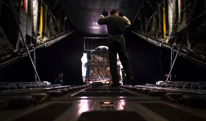Loadmasters from the 37th Airlift Squadron prepare a C-130J Super Hercules for flight Nov. 25, 2015, at Ramstein Air Base, Germany. Aircrew members flew to U.S. Army Garrison Grafenwoehr, Germany, for airdrop training. (U.S. Air Force photo/Staff Sgt. Sara Keller)