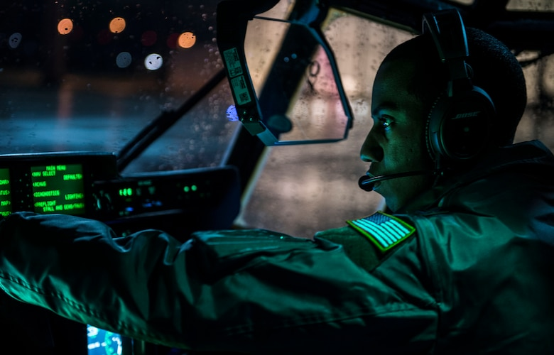 Capt. Chris Scott, 37th Airlift Squadron pilot, prepares for a flight Nov. 25, 2015, at Ramstein Air Base, Germany. Aircrew members spent more than 7 hours to prepare and fly an air drop training mission over U.S. Army Garrison Grafenwoehr, Germany. (U.S. Air Force photo/Staff Sgt. Sara Keller)