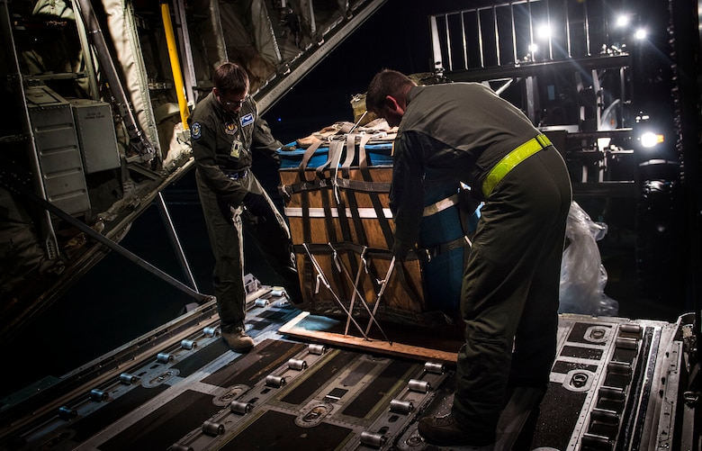 Loadmasters from the 37th Airlift Squadron load water onto a C-130J Super Hercules Nov. 25, 2015, at Ramstein Air Base, Germany. The water was used to simulate supplies being airdropped during a training mission over Grafenwoehr, Germany . (U.S. Air Force photo/Staff Sgt. Sara Keller)