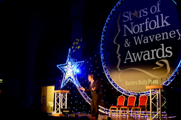 David Whiteley, BBC Radio and Stars of Norfolk and Waveney Awards host, provides opening remarks during the ceremony at St. Andrews Halls, Norfolk, England, Dec. 3, 2015. Staff Sgt. Eli Gordon, 492nd Aircraft Maintenance Unit activity security manager, was named the winner for the Armed Services Person of the Year award. (U.S. Air Force photo by Senior Airman Erin Trower)