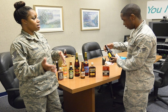 Tech. Sgt. La' Kisha Tucker, Robins ADAPT program noncommissioned officer in charge, and Senior Airman Mourice McDuffie, Mental Health technician, set up props used for education and prevention counseling. The Air Force recognizes alcoholism as a preventable, progressive, treatable and non-compensable disease that affects the entire family. The ADAPT Clinic provides prevention, substance abuse education, assessments and rehabilitation. (U.S. Air Force photo by Ray Crayton)