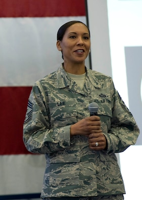 Chief Master Sgt. Sonia Lee, 28th Bomb Wing command chief, addresses Team Ellsworth at an all call at Ellsworth Air Force Base, S.D., Dec. 3, 2015. Lee touched on what the Air Force core values mean to her and discussed her personnelist background, transition to the bomber community and family. (U.S. Air Force photo by Senior Airman Hailey R. Staker/Released)