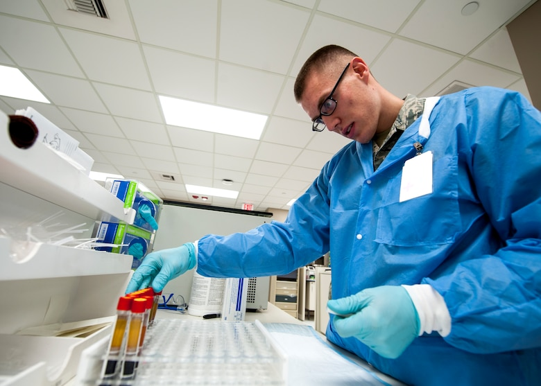 Senior Airman David Gehring, 92nd Medical Support Squadron medical laboratory technician, conducts lab work Dec. 1, 2015, Fairchild Air Force Base, Wash. Quality control serum has pre-determined results in order to determine the result range of the analyzer being used. (U.S. Air Force illustration/Airman 1st Class Sean Campbell)