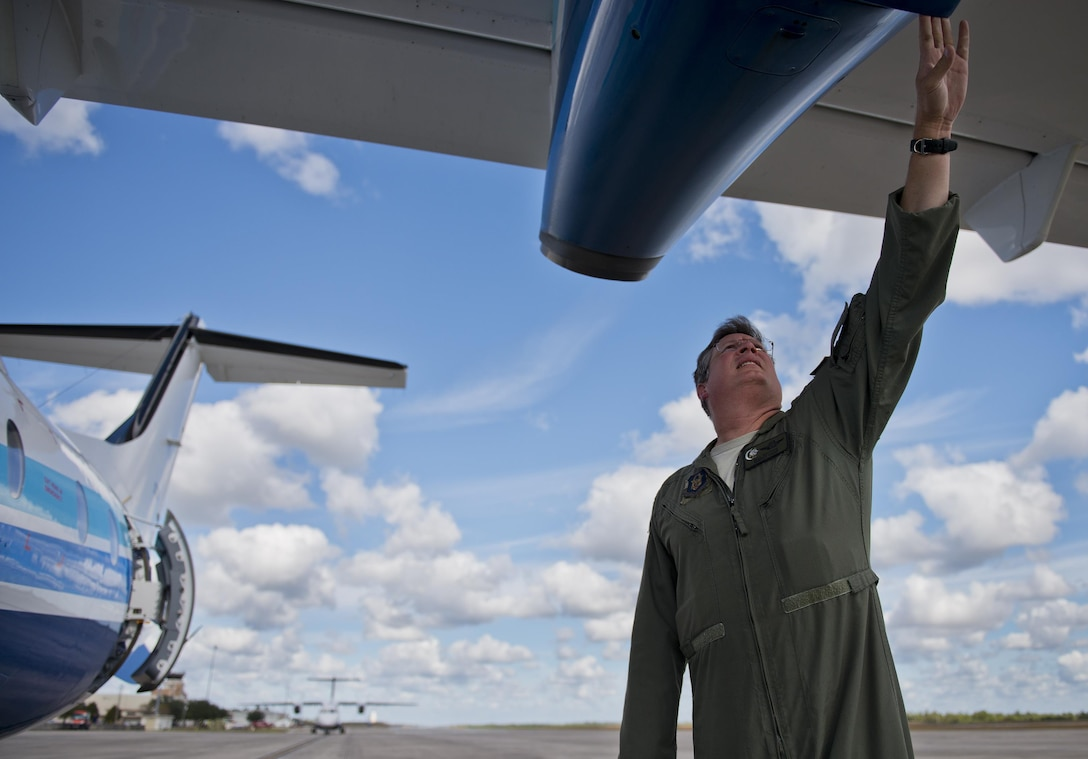 Senior Master Sgt. Bill Bethke, 711th Special Operations Squadron, completes his postflight checks on a C-146 Wolfhound at Duke Field, Fla., Oct. 21.  The Air Force Special Operations Wing aircraft are used specifically in the training and operation of the 919th Special Operations Wing's nonstandard aviation mission.  (U.S. Air Force photo/Tech. Sgt. Sam King)