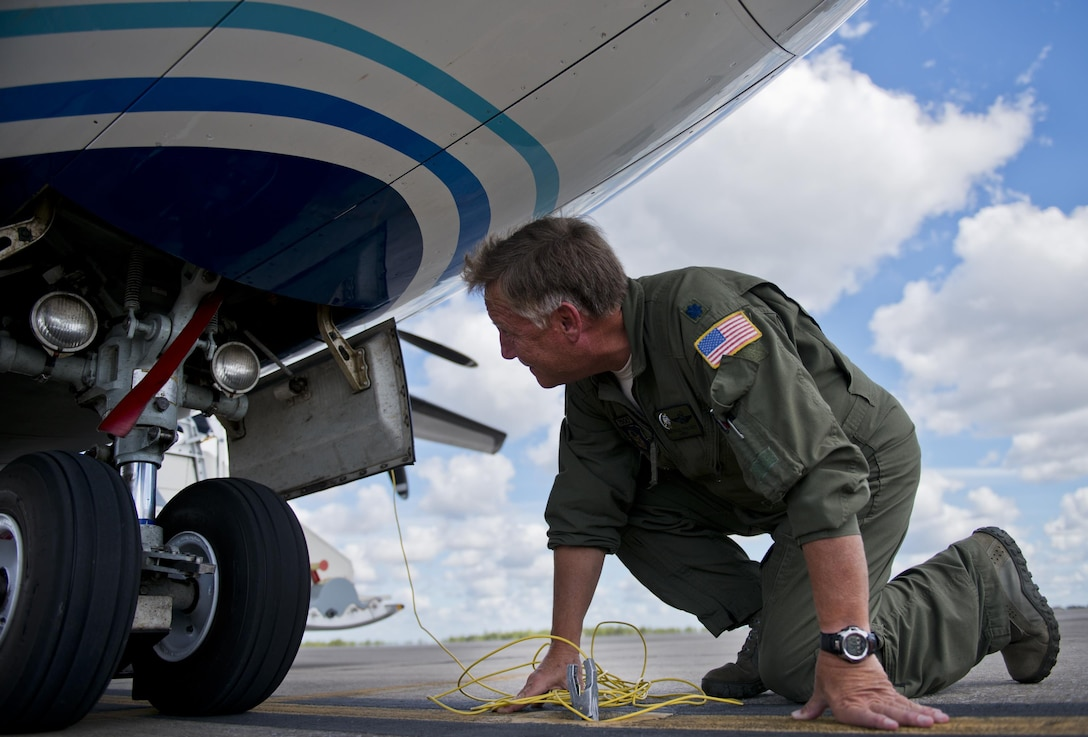 Lt. Col. Michael Theriot, 711th Special Operations Squadron, completes his postflight checks on a C-146 Wolfhound at Duke Field, Fla., Oct. 21.  The Air Force Special Operations Wing aircraft are used specifically in the training and operation of the 919th Special Operations Wing's nonstandard aviation mission.  (U.S. Air Force photo/Tech. Sgt. Sam King)