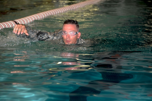 Master Sgt. Brad Rose, a 185th ARW Security Forces member, completes the timed swim while wearing his uniform during testing for the German Armed Forces Proficiency Badge on Nov. 7, 2015 in Ames, Iowa. (Official Air Guard photo by Capt. Jeremy J. McClure/Released)