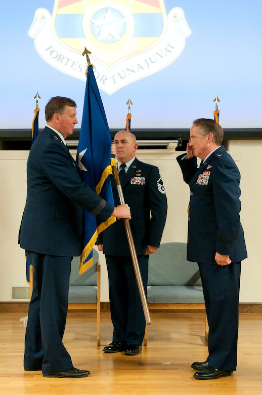 Brig. Gen. Gregory L. Nelson passes his general officer flag to Kentucky's adjutant general, Maj. Gen. Edward W. Tonini, during Nelson's retirement ceremony at the Kentucky Air National Guard Base in Louisville, Ky., Nov. 8, 2015. Nelson, who most recently served as vice director for strategy, policy, plans and international affairs at the National Guard Bureau, completed more than 40 years of faithful service to U.S. Air Force and Kentucky Air National Guard. (U.S. Air National Guard photo by Tech. Sgt. Vicky Spesard)