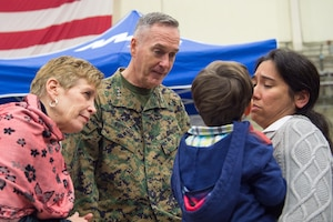 U.S. Marine Corps Gen. Joseph F. Dunford Jr., the chairman of the Joint Chiefs of Staff, and his wife, Ellyn Dunford, meet U.S. service members and their families after a USO show on Naval Air Station Sigonella, Italy, Dec. 5, 2015. The chairman is traveling with entertainers to visit deployed service members during the holidays. DoD photo by D. Myles Cullen