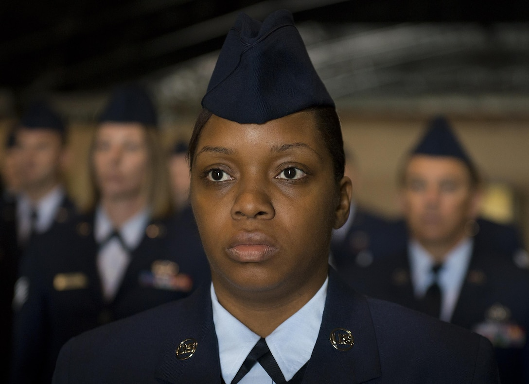 Senior Airman Shaniqua Johnson, 919th Special Operations Civil Engineer Squadron, stands at attention prior to an open ranks inspection Dec. 5 at Duke Field, Fla.  The goal of the inspection is for the Airmen to ensure their service dress and appearance conform to Air Force standards.  (U.S. Air Force photo/Tech. Sgt. Sam King)