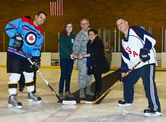 Canadian detachment Commander Lt. Col. Mark Roberts awaits the puck drop at the start of the 21st Annual CanAm Hockey Classic at the Sprinker Rink on Feb 26, 2015.  Airmen from the Washington Air National Guard's Western Air Defense Sector (WADS) competed against the Canadian detachment for this years trophy (courtesy photo/Released).