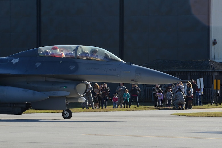 Swamp Fox Airmen and their families welcome the arrival of Santa Claus at McEntire Joint National Guard Base, S.C., Dec. 5, 2015.  Follow Santa as he travels the globe by visiting www.noradsanta.org.  (U.S. Air National Guard photo by Airman 1st First Class Ashleigh S. Pavelek/Released)