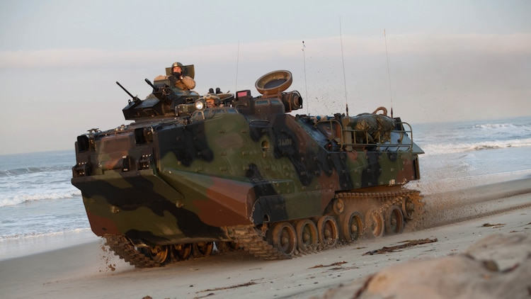 An amphibious assault vehicle proceeds to assault the objective after conducting an amphibious landing during Exercise Steel Knight aboard Marine Corps Base Camp Pendleton, Calif., Dec. 4, 2015. The U.S. Navy and Marine Corps continue to combine efforts to revitalize, refine and strengthen fundamental amphibious capabilities, and reinforce the Navy and Marine Corps team. Steel Knight will test  the Marine Air Ground-Task Force's expeditionary capabilities through realistic, scenario-driven training.