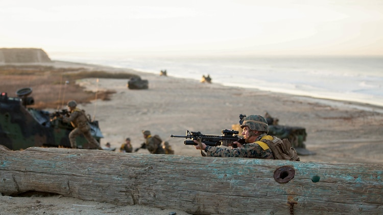 A rifleman holds security outside a simulated combat town after conducting a beach landing during Exercise Steel Knight aboard Marine Corps Base Camp Pendleton, Calif., Dec. 4, 2015. The U.S. Navy and Marine Corps continue to combine efforts to revitalize, refine and strengthen fundamental amphibious capabilities, and reinforce the Navy and Marine Corps team. Steel Knight will test the Marine Air Ground-Task Force's expeditionary capabilities through realistic, scenario-driven training.