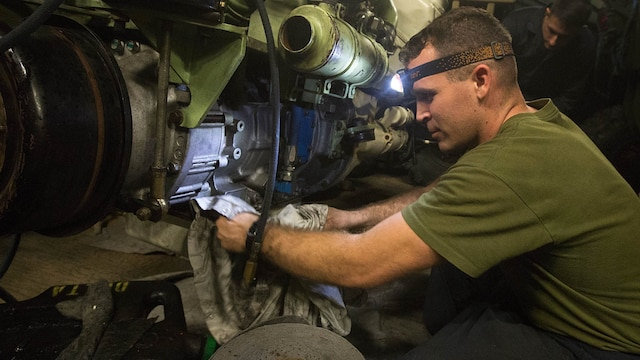 Sgt. Kevin S. Kuykendall, a light armored vehicle crewman with Light Armored Reconnaissance Company, Battalion Landing Team 2/6, 26th Marine Expeditionary Unit, cleans an LAV engine aboard the amphibious assault ship USS Kearsarge Dec. 4, 2015. Crewman with the company assisted repairmen that were servicing an LAV engine with an oil leak. The 26th MEU is embarked on the Kearsarge Amphibious Ready Group and is deployed to maintain regional security in the U.S. 5th Fleet area of operations.