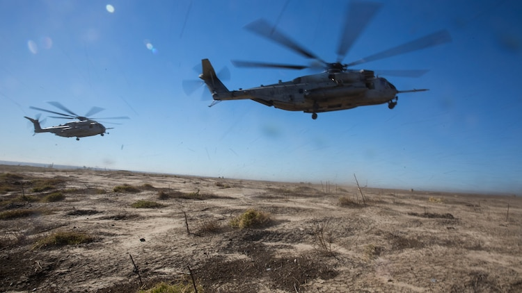 Two CH-53E Super Stallions prepare to land during section Confined Area Landings board Marine Corps Base Camp Pendleton, Calif., Dec. 2, 2015. Marines with HMH-361 conducted section Confined Area Landings and Field Carrier Landing Practices to fulfill training requirements for landing aboard a Navy ship.
