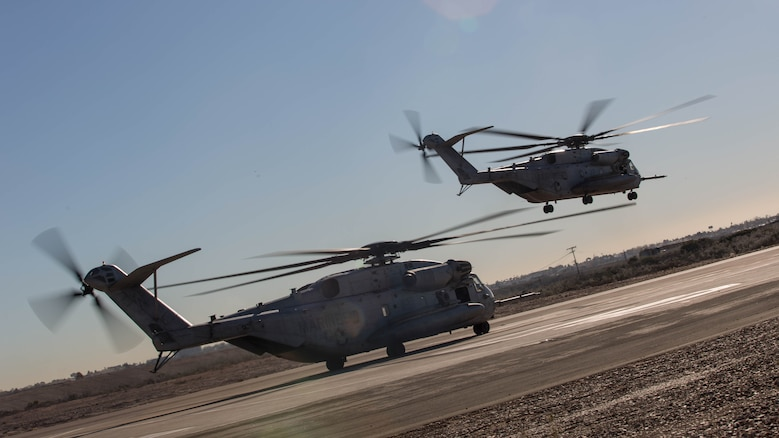 Two CH-53E Super Stallions with Marine Heavy Helicopter Squadron 361 conduct Field Carrier Landing Practices aboard Marine Corps Air Station Miramar, Calif., Dec. 2, 2015. Marines with HMH-361 conducted section Confined Area Landings and Field Carrier Landing Practices to fulfill training requirements for landing aboard a Navy ship.