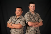 Capts. Christopher Fukui and Joshua McNelley are assigned to the 18th Logistics Readiness Squadron at Kadena Air Base, Japan. Both Airmen are descendants of sailors who fought in the Battle of Midway during World War II. Fukui's great-grandfather, Chisato Morita, commanded the Imperial Japanese Navy Midway Flying Corps aboard the aircraft carrier Akagi and McNelley's grandfather, Ray Sorton, a U.S. Navy Sailor, manned an anti-aircraft gun during the battle. (U.S. Air Force photo/Senior Airman John Linzmeier)