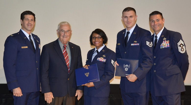 "Staff Sgts. Tracy Parks, 920th Force Support Squadron and Jason, Coker, 920th Aircraft Maintenance Squadron, were presented with the William H. Pitsenbarger Award for pursuing higher education during the Community College of the Air Force graduation ceremony at Patrick Air Force Base, Florida, Dec. 5.  The airmen received a certificate and a $400 check from the Air Force Association. From left: Col. Paul ""Brett"" Howard, 920th Rescue Wing vice commander, retired Chief Master Sgt. Chris Bailey, president of the local Air Force Association chapter; and 920th RQW Command Chief Tim Bianchi. (U.S. Air Force photo/2nd Lt. Annamarie Wyant)"