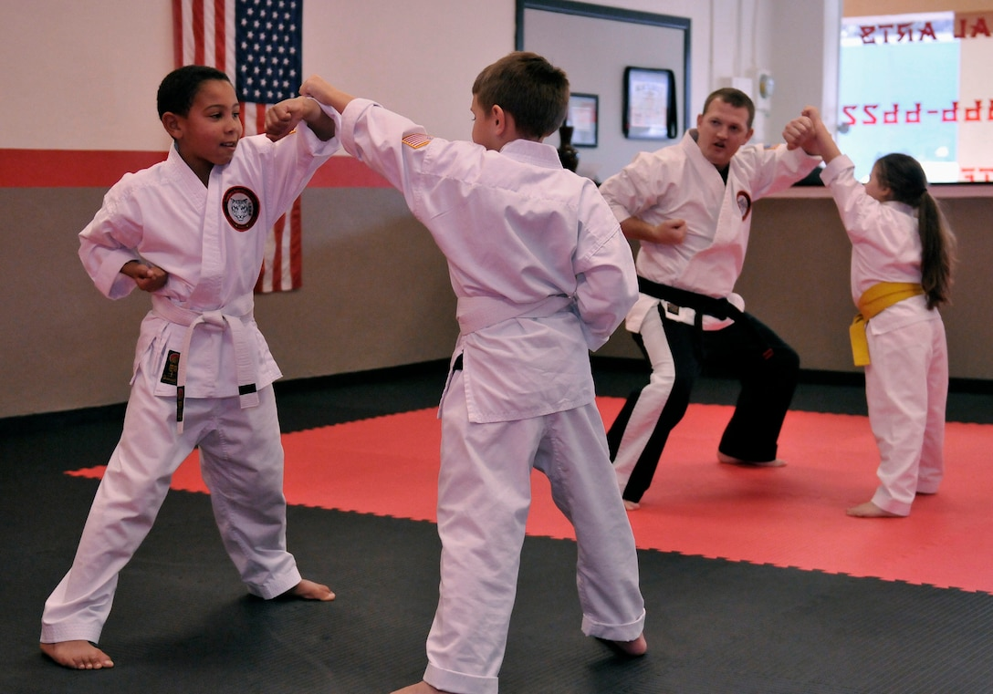 Staff Sgt. Chris Cowgill, a command post controller for the 125th Fighter Wing, leads a children's Shoalin Kempo class Jan. 9, 2015, at his studio in Orange Park, Fla. Cowgill opened the studio with his wife and business partner, and he teaches Shoalin Kempo to students of all ages during his off-duty days. (U.S. Air National Guard photo/Tech. Sgt. William Buchanan)