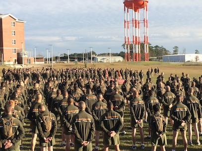 Marines from Marine Corps Engineer School (MCES) form for accountability and warm up exercises prior to the MCES Holiday Fun Run on Dec. 4, 2015 at Courthouse Bay, Camp Lejeune, N.C.