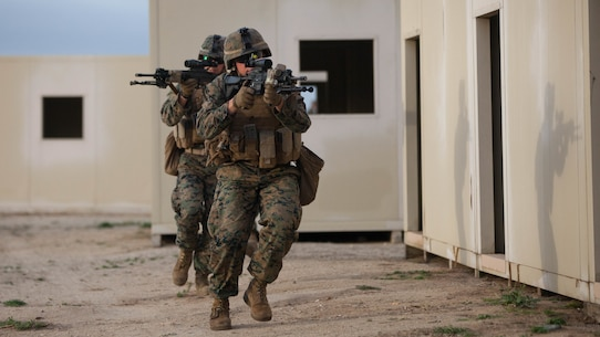 1st Battalion, 1st Marine Regiment infantrymen tactically move from building to building in a simulated combat zone during Exercise Steel Knight 2016 at Marine Corps Base Camp Pendleton, Calif., Dec. 4, 2015. 1st Marine Division has conducted Steel Knight for the past three years, making this the fourth iteration of the exercise. Steel Knight will test I Marine Expeditionary Force's amphibious capabilities through realistic, scenario-driven training.