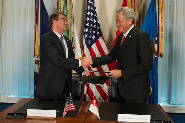 U.S. Defense Secretary Ash Carter and Singaporean Defense Minister Ng Eng Hen shake hands after signing the Enhanced Defense Cooperation Agreement during a meeting at the Pentagon, Dec. 7, 2015. DoD photo by Air Force Senior Master Sgt. Adrian Cadiz