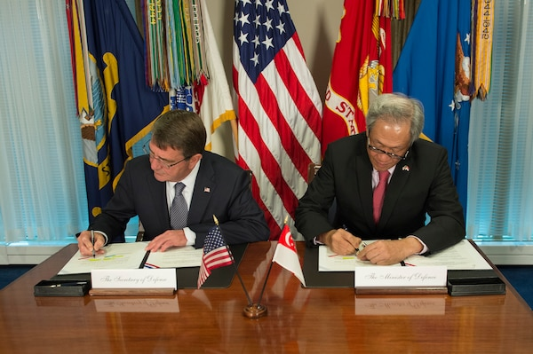 U.S. Defense Secretary Ash Carter and Singaporean Defense Minister Ng Eng Hen sign the Enhanced Defense Cooperation Agreement during a meeting at the Pentagon, Dec. 7, 2015. DoD photo by Air Force Senior Master Sgt. Adrian Cadiz