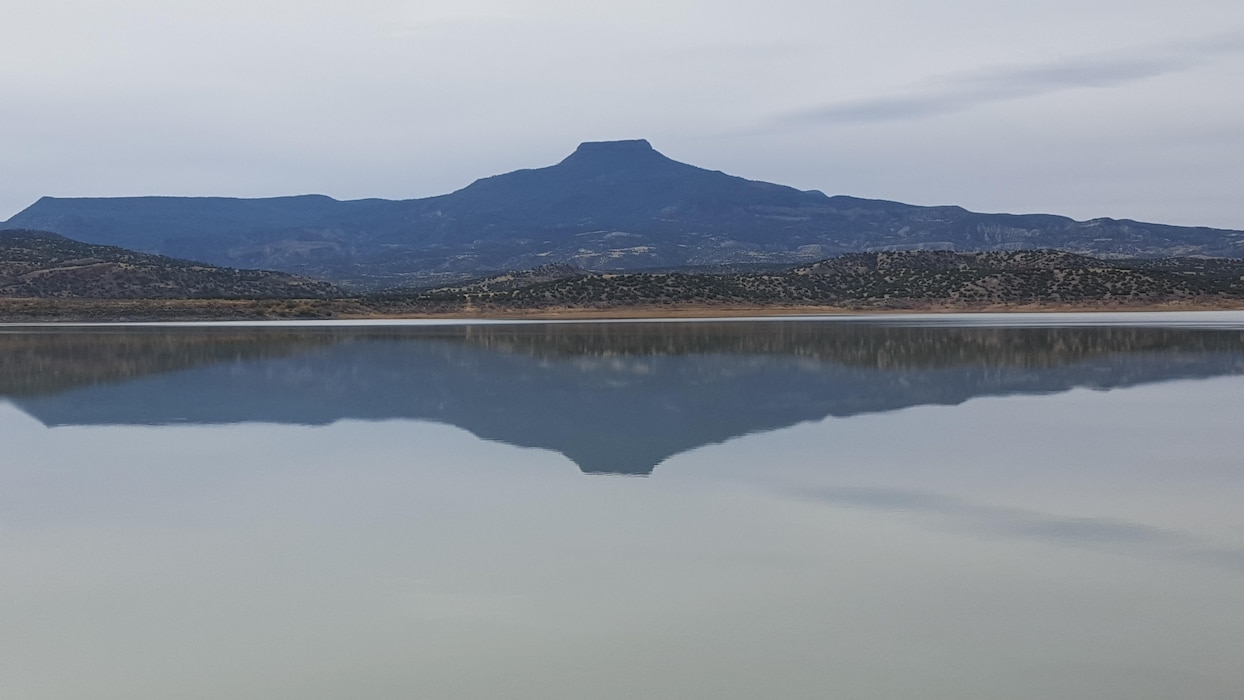 ABIQUIU LAKE, N.M. – Cerro Pedernal reflects in Abiquiu Lake. Photo by Jeremy Decker, Oct. 28, 2015.