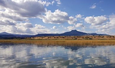 ABIQUIU LAKE, N.M. – View of Cerro Pedernal from a boat in the lake. Photo by Richard Banker, Oct. 1, 2015.