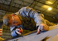 Airman 1st Class Jesse Gordon, a 436th Maintenance Squadron crew chief, removes coder pins from an aero seal on a C-5M Super Galaxy during a Maintenance Steering Group-3 Major inspection Dec. 2, 2015, in the isochronal dock at Dover Air Force Base, Del. The ISO dock at Dover AFB is the only maintenance dock in the Air Force capable of performing MSG-3 inspections of C-5 aircraft. (U.S. Air Force photo/Senior Airman William Johnson)