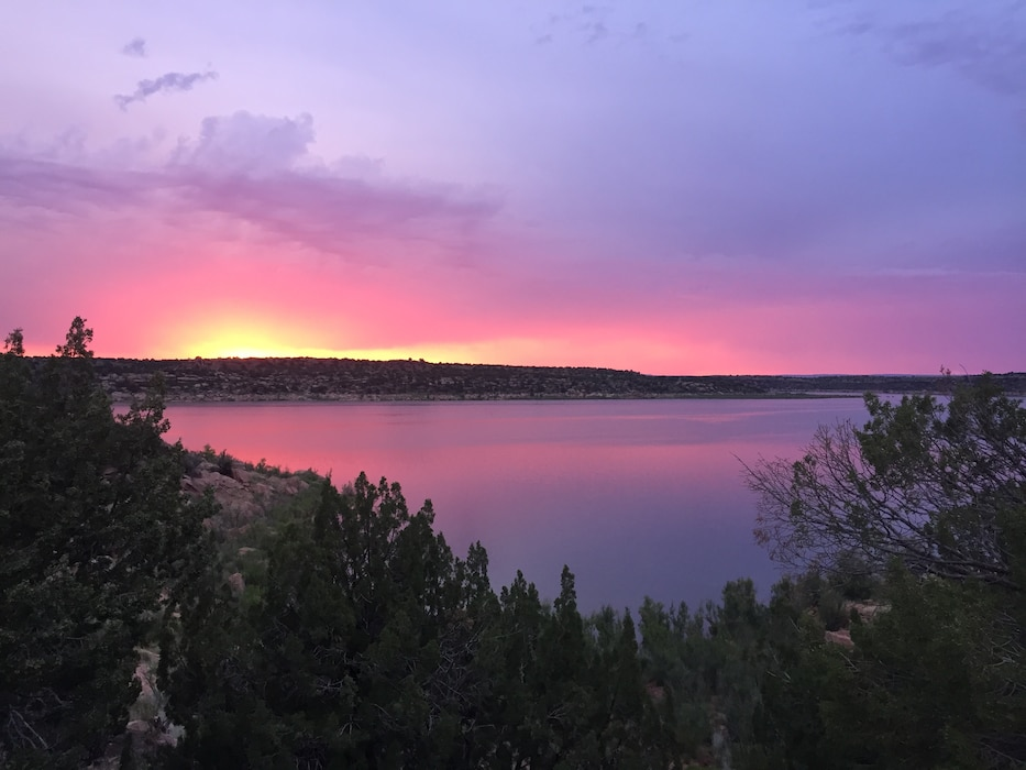CONCHAS LAKE, N.M. – Photo of a sunset taken on the north side of the lake. Just as the sun was about to go down, it cast beautiful shades of pink and purple on the water. Photo by Nadine Carter, June 26, 2015.