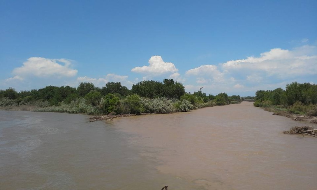 PUEBLO, Colo. – The confluence of Fountain Creek and the Arkansas River.  Fountain Creek is on the right; the Arkansas River is on the left. Fountain Creek flows into the Arkansas below Pueblo Reservoir.  A team from the District traveled to Pueblo to assess flood damage on Fountain Creek due to widespread flooding across Colorado in May and June, 2015. Photo by Amy Louise, June 17, 2015.