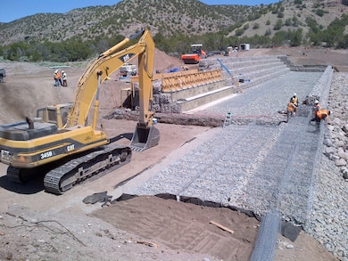 SANTA CLARA PUEBLO, N.M. – One of the check structures under construction in Santa Clara Canyon. The structure will help reduce the risk of flooding from rain falling on the Los Conchas burn scar in the canyon to the pueblo downstream. Photo by Jeff Daniels, June 2, 2015.
