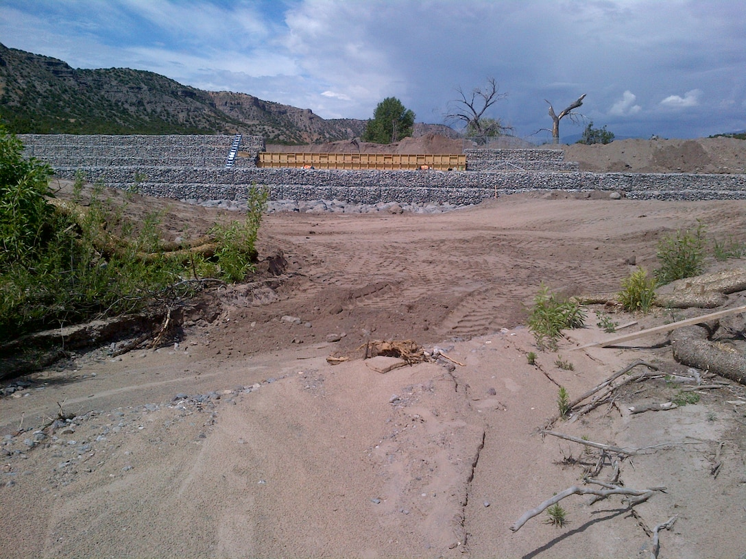 SANTA CLARA PUEBLO, N.M. – One of the check structures under construction in Santa Clara Canyon. The structure will help reduce the risk of flooding from rain falling on the Los Conchas burn scar in the canyon to the pueblo downstream. Photo by Jeff Daniels, June 9, 2015. This was a 2015 photo drive entry.