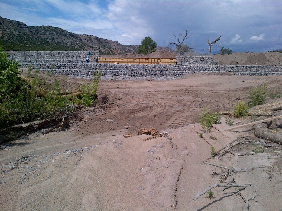SANTA CLARA PUEBLO, N.M. – One of the check structures under construction in Santa Clara Canyon. The structure will help reduce the risk of flooding from rain falling on the Los Conchas burn scar in the canyon to the pueblo downstream. Photo by Jeff Daniels, June 9, 2015.