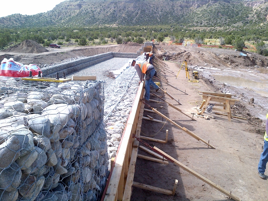 SANTA CLARA PUEBLO, N.M. – One of the check structures under construction in Santa Clara Canyon. The structure will help reduce the risk of flooding from rain falling on the Los Conchas burn scar in the canyon to the pueblo downstream. Photo by Jeff Daniels, July 6, 2015.