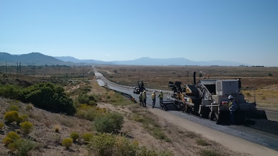 KIRTLAND AIR FORCE BASE, N.M. – A construction crew works on the asphalt of a base road. Photo by Nate Weander, Sept. 12, 2015.