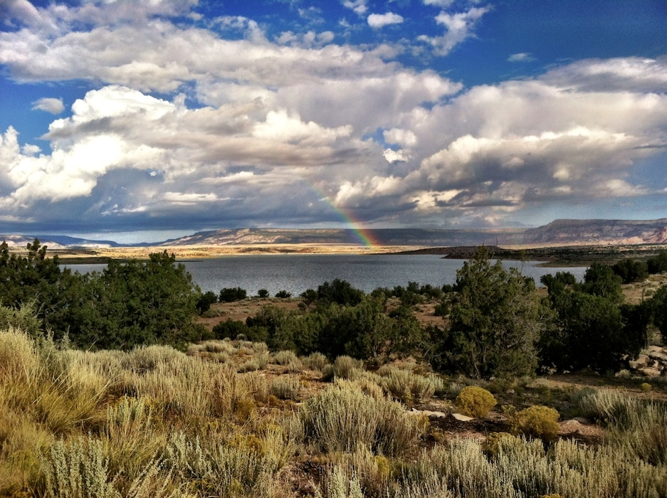 ABIQUIU LAKE, N.M. – The end of a rainbow is seen at Abiquiu Lake. The photo was taken from the Rianna Campground at the lake, Sept. 15, 2015. Photo by Austin Kuhlman.