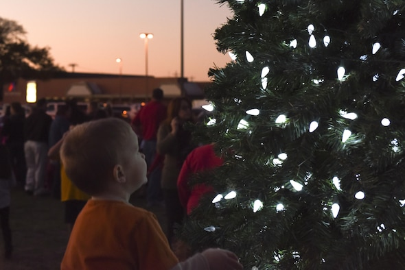 A child stares at lights at the tree lighting ceremony at the Parade Field on Goodfellow Air Force Base, Texas, Dec. 3, 2015. The base invited all personnel and their families to the ceremony to celebrate the holiday season. (U.S. Air Force photo by Airman Chase Sousa/Released)
