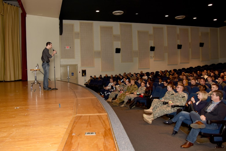 Matt the Knife, magician and mentalist, speaks to a crowd before his performance at the theater on Goodfellow Air Force Base, Texas, Dec. 4, 2015. During his performance, Matt escaped a straitjacket, swallowed a clothes hanger and recreated a voodoo ritual. (U.S. Air Force photo by Senior Airman Joshua Edwards/Released)