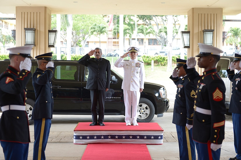 CAMP H.M. SMITH, Hawaii (Dec. 7, 2015) Commander of U.S. Pacific Command (PACOM), Adm. Harry B. Harris Jr., right, and India Defence Minister, Manohar Parrikar, render honors during a welcome ceremony. During this first-ever visit by an India Defense Minister to the PACOM headquarters, Parrikar met with Harris to discuss partnerships and the maritime security cooperation in the Indo-Asia-Pacific.