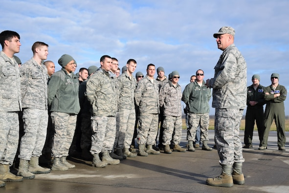 Maj. Gen. Vollmecke talks with Airmen from the 74th Expeditionary Fighter Squadron and answers their questions during a visit to Papa Air Base, Hungary, Dec. 2. The 74th EFS forward deployed to Hungary as part of Theater Security Package to conduct training and exercises alongside the Hungarian Air Force to increase readiness and enhance interoperability. (U.S. Air Force photo/ Capt. Lauren Ott)