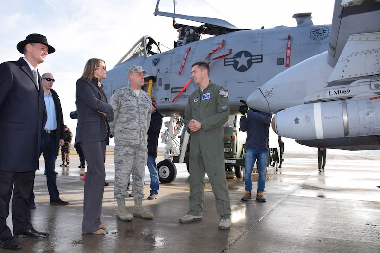 Maj. Gen. Vollmecke receives a briefing on the A-10C Thunderbolt II by 1st Lt. Mecadon of the 74th Expeditionary Fighter Squadron during a visit to Papa Air Base, Hungary, Dec. 2. The 74th EFS forward deployed to Hungary as part of Theater Security Package to conduct training and exercises alongside the Hungarian Air Force to increase readiness and enhance interoperability. Vollmecke was accompanied by U.S. Ambassador to Hungary, Colleen Bell and Mr. Peter Siklosi, the Hungarian MoD Deputy State Secretary for Defense Policy and Defense Planning, (U.S. Air Force photo/ Capt. Lauren Ott)