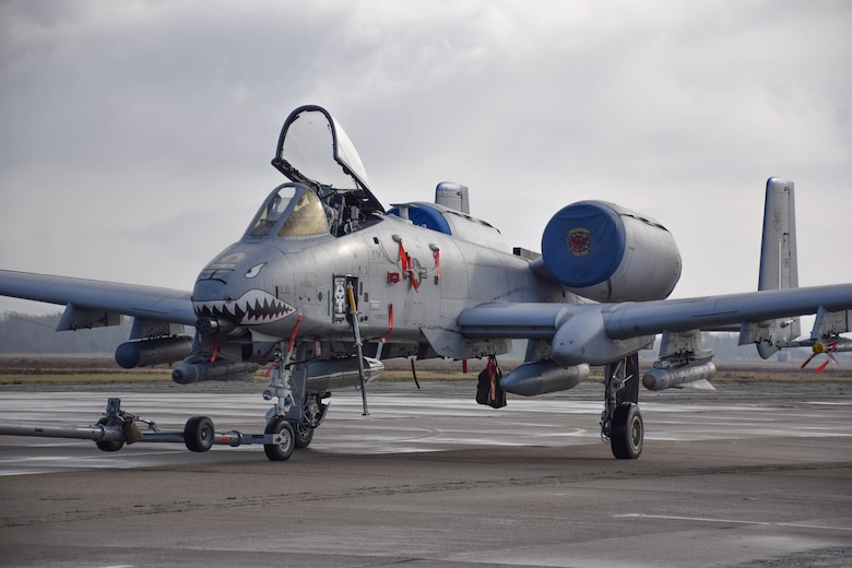 An A-10C Thunderbolt II from the 74th Expeditionary Fighter Squadron is parked on the ramp prior to a training flight at Papa Air Base, Hungary, Dec 2, where it is currently participating in a micro-deployment as part of a Theater Security Package.  The purpose of the deployment is to conduct training and exercises alongside the Hungarian Air Force to increase readiness and enhance interoperability. (U.S. Air Force photo/ Capt. Lauren Ott)