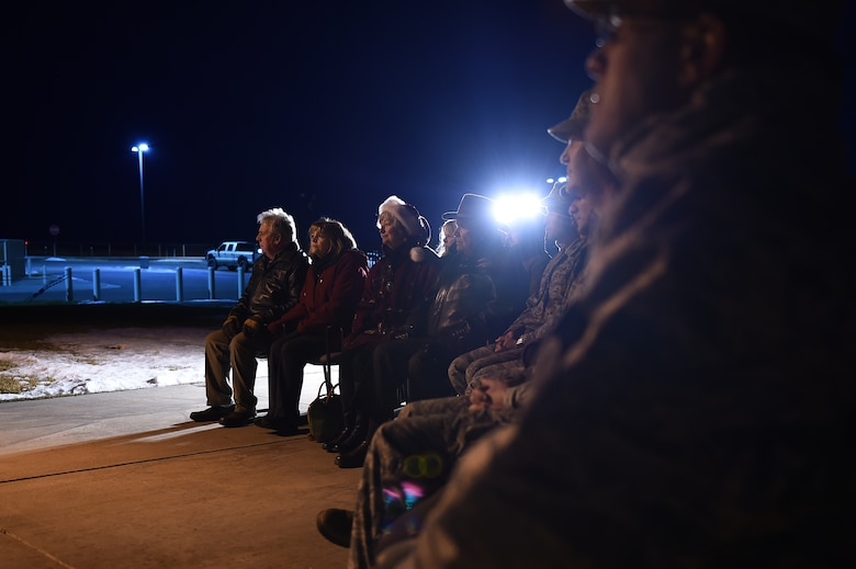 Team Buckley members observe a tree-lighting ceremony Dec. 3, 2015, on Buckley Air Force Base, Colo. The ceremony takes place every year to honor Senior Airman Kristopher Mansfield, who was killed in a drunk driving accident in 2004. (U.S. Air Force photo by Airman First Class Gabrielle Spradling/Released)