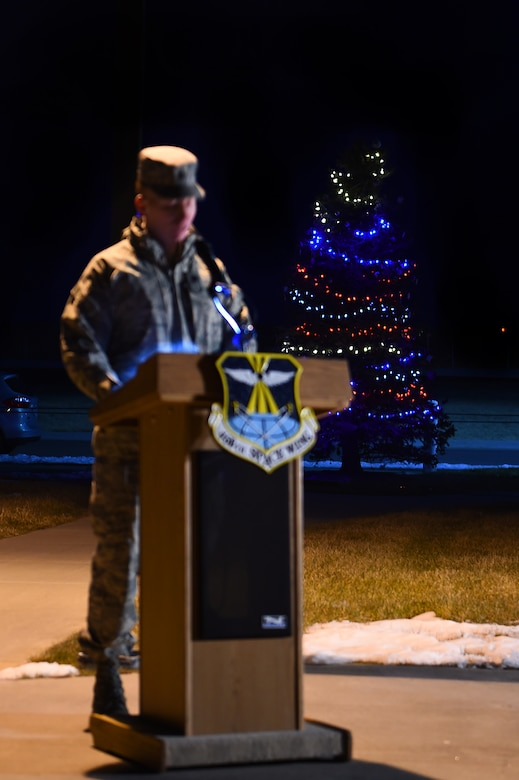 Lt. Col. Christopher Kennedy, 460th Space Communications Squadron commander, speaks during a tree-lighting ceremony Dec. 3, 2015, on Buckley Air Force Base, Colo. The ceremony takes place every year to honor Senior Airman Kristopher Mansfield, who was killed in a drunk driving accident in 2004. (U.S. Air Force photo by Airman First Class Gabrielle Spradling/Released)